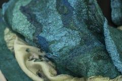 Tyg klädde med filt för att snöra åt grönt dekorativt, design, royaltyfria bilder