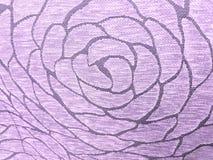 tyg med abstrakt design i skuggor av rosa färger, texturerad bakgrund Royaltyfri Fotografi