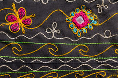 Tyg med blom- bevekelsegrundbakgrund Arkivfoton