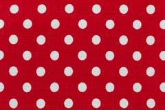Tyg med den röda och vita prickmodellen Arkivbild