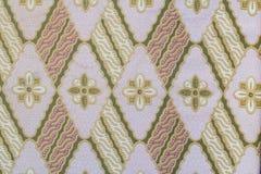 Tyg med textur och bakgrund för blommamodell Royaltyfri Fotografi