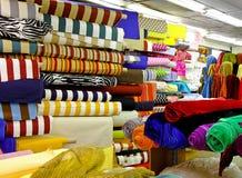 tyg rullar textilen Arkivfoto