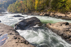 Tygart River cascades over rocks at Valley Falls S. The Tygart River cascades over rocks at Valley Falls State Park in Fairmont, West Virginia, fog over the Royalty Free Stock Photography