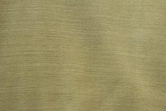 Tygbakgrund av den gröna closeupen Arkivbild