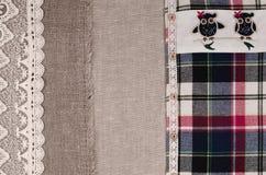 Tygbakgrund Linnetyg, säckväv, plädflanellskjorta Fotografering för Bildbyråer