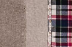 Tygbakgrund Linnetyg, säckväv, plädflanellskjorta Arkivfoton
