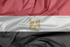Tygflagga av Egypten Veck av egyptisk flaggabakgrund fotografering för bildbyråer