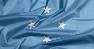 Tygflagga av Federated States of Micronesia Veck av Mikronesien flaggabakgrund royaltyfri fotografi