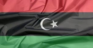 Tygflagga av Libyen Veck av libysk flaggabakgrund royaltyfri foto
