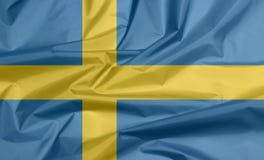 Tygflagga av Sverige Veck av svenskflaggabakgrund royaltyfria foton