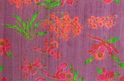 Tyg som skrivar ut thailändsk silk. Arkivbild