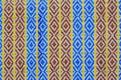 Tygtextur i blåa röda och yellownband texturerar backgroun Royaltyfri Foto