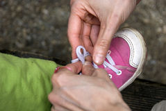 Tying Baby Shoes Royalty Free Stock Photo