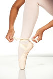 Tying ballet shoes Stock Photos