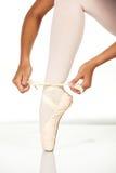 Tying ballet shoes Stock Photos