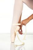 Tying ballet shoes Royalty Free Stock Images