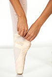 Tying ballet shoes Royalty Free Stock Image