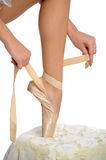 Tying ballet slippers Stock Photography