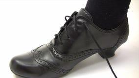 Tying a Black Shoe. Canon HV30. HD 16:9 1920 x 1080 at 25.00 fps. Progressive scan. Photo JPG Compression. No audio stock video