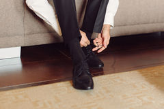 Tying Bow on Shoes Royalty Free Stock Images