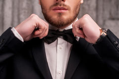 Tying a bow tie. Royalty Free Stock Photography