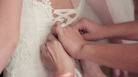 Tying the bride dresses, Morning bride stock footage