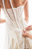 Tying brides dress Royalty Free Stock Photos