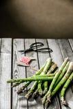 Tying bundles of fresh farm asparagus Stock Photos