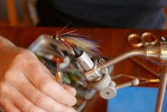 Tying a classic Magog smelt fly. Adding the finishing touches on a classic Magog Smelt salmon fly Royalty Free Stock Photography