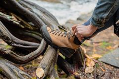 Tying hiking boot stock photography