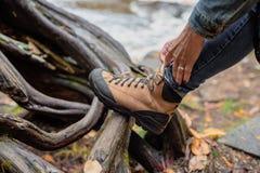 Tying hiking boot stock image