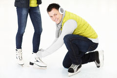 Tying ice skates Royalty Free Stock Photos