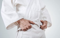 Tying kimono belt close up image Royalty Free Stock Image