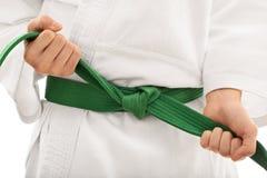 Tying a kimono belt Stock Photography