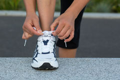 Tying laces Stock Photography
