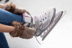 Tying laces of ice figure skates Royalty Free Stock Photos