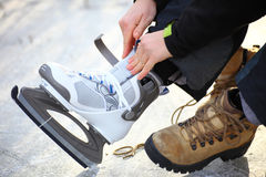 Tying laces of ice hockey skates skating rink Royalty Free Stock Photo