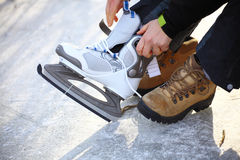Tying laces of ice hockey skates skating rink Stock Image