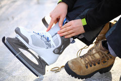 Tying laces of ice hockey skates skating rink Royalty Free Stock Images