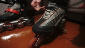 Tying of laces on roller skates.  stock video footage