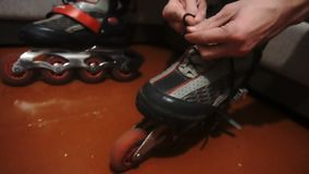 Tying of laces on roller skates.  stock video