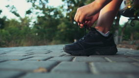 Tying laces on sneakers shoes slow motion stock footage