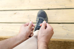 Tying my shoes at the city park Stock Images