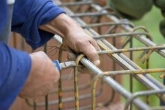 Tying reinforcement preparation for concreting.  Stock Photo