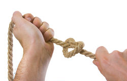 Tying ropes Stock Images
