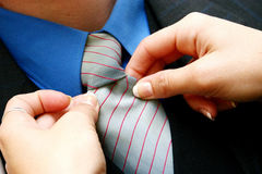 Tying shirts Royalty Free Stock Photography