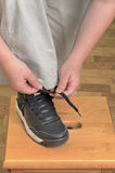 Tying Shoe. Young person tying a lace on his shoe Royalty Free Stock Image