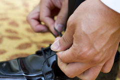 Tying shoe laces Stock Photos
