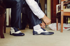 Tying Shoe Strings Stock Images