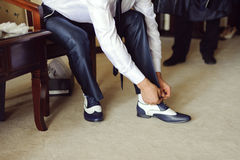 Tying Shoe Strings Royalty Free Stock Photo